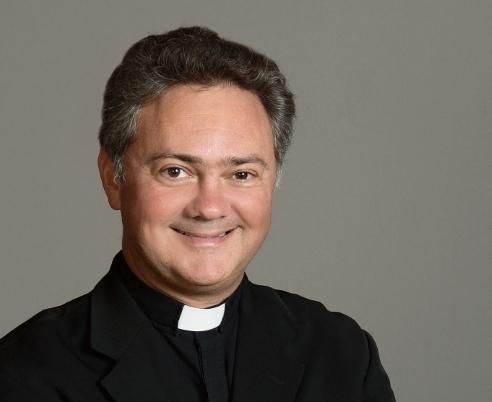 Rev. John P. Melnick